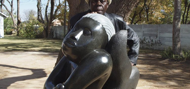 Sylvester Mubayi with one of his sculptures