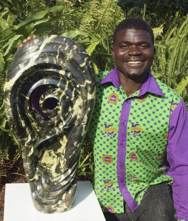 Zimbabwean sculptor Remembrance Chikuruwo portrait photo