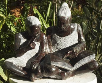 Shona sculpture Teach Me To Read by Jonathan Mhondorohuma
