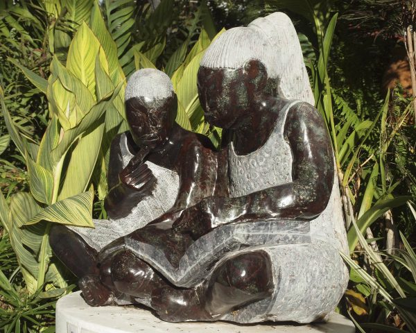 Shona sculpture Teach Me To Read by Jonathan Mhondorohuma