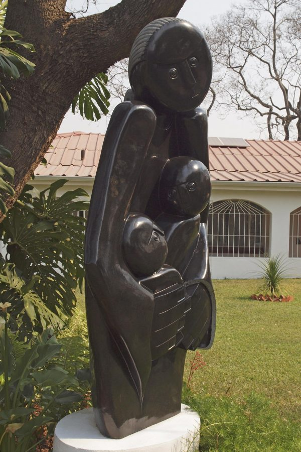 Shona stone sculpture Protective Mother by Edward Chiwawa - front left