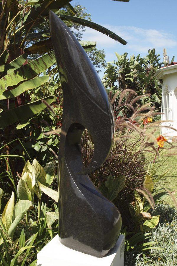 Abstract Shona stone sculpture Kingfisher by Nesbert Mukomberanwa front left